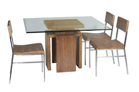 table round glass dining with wooden base sloped ceiling