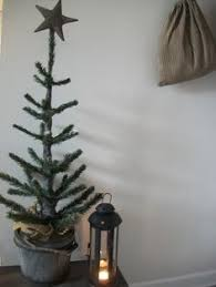 turn a cheap tree into a big tree that looks like a feather