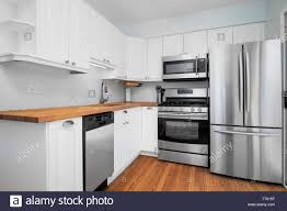 small kitchens with white cabinets a small kitchen with stainless steel appliances white