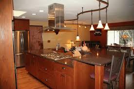 dark cherry kitchen cabinets single bulb hanging light exposed grey brick tile of backsplash