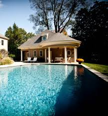 pool house with circular portico and outdoor kitchen pool