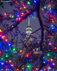 christmas lights sparkle in front of one world trade center