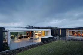 modern steel framed home in super minimalist interior design photo