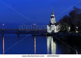 beautiful church illuminating lights reflected stock photo