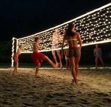 add christmas lights to a volleyball net to play at night ideas