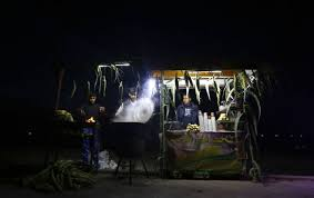 topshot palestinian vendors use battery powered lights as