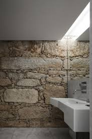77 best wc images on pinterest bathroom ideas room and architecture design offices by ada atelier de arquitectura bathroom stone wall with light
