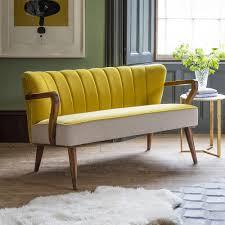 2 seater sofa in mustard yellow velvet and linen