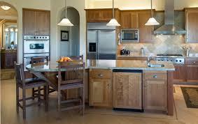 cherry wood espresso shaker door pendant lighting over kitchen