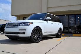lexus coupe on 24s full size range rover on 24