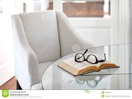 armchair with book and eyeglasses interior decoration stock image