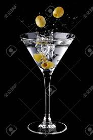 martini splash martini cocktail with olives and splash stock photo picture and