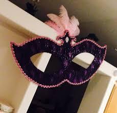 large masquerade mask hanging decorations made using cardboard