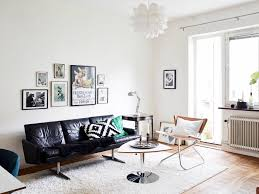 Midcentury Modern Living Room - black leather sofa and brown wooden chair also triangle brown