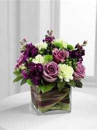 Vase To Vase Florist Compact Leaf Lined Vase Of Purple Flowers And Green Flowers