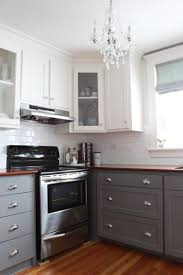 Grey Kitchen Cabinets by Grey Stained Kitchen Cabinets White Metal Chrome Over Range