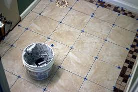 How To Whiten Bathroom Tiles How To Install Bathroom Floor Tile How Tos Diy