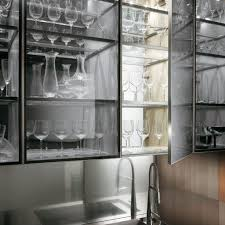 Interior Design Of A Kitchen Transparent Glass Cabinet With A Kitchen Faucet In A Natural