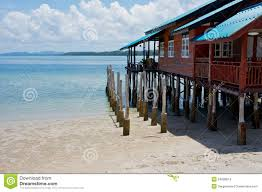house on stilts at the tropical beach stock images image 24898814
