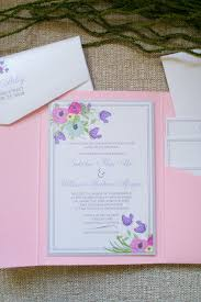5x7 pink pocket wedding invitation with pastel florals in purple