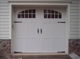 Overhead Door Coupon by Door White Haas Garage Doors With Amerock And Wooden Wall