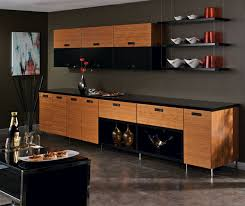 the horizontal lines of the bamboo kitchen cabinets visually