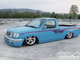lifted nissan hardbody 1998 nissan frontier blue curse mini truckin u0027 magazine
