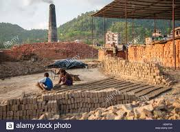 making adobe to rebuild houses lele village 16 kms from patan