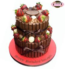 chocolate overload cake with chocolate covered strawberries