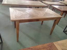 recycled elm dining table with parquet top matching coffee table