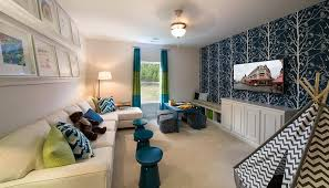 living room playroom family room with stacked picture ledges over sofa contemporary