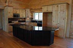 solid pine kitchen cabinets pine cabinets black counter i like the contrast on the
