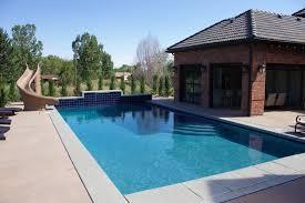 backyard pool with slide integrity pool builders