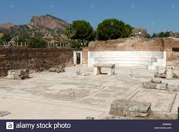 semicircular apse and marble bench flanked by double lion statues