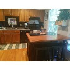 home styles monarch kitchen island home styles monarch distressed oak and granite top black wooden