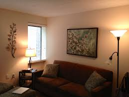 simple apartment living room color ideas with nice wall art and