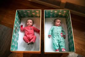 new parents get baby boxes to encourage safe sleep shots