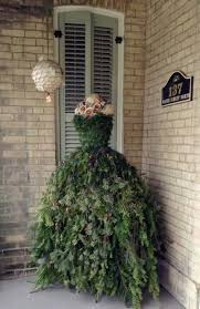 christmas tree dress she attaches tree branches to the dress form what it becomes