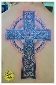 cross with vines tattoo celtic cross with rose in center and