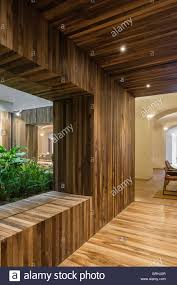 timber clad wall and corridor leading towards entrance and dinning
