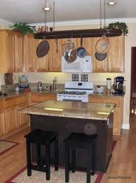 kitchen island with hanging pot rack wall mounted hanging pot rack teak cabinet wooden varnish islands
