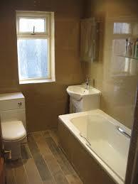 modern minimalist living room with brown hardwood floor tile