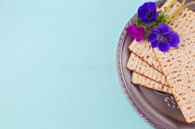seder matzah passover background with matzah seder plate and flower