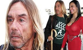 Hotwife Meme - iggy pop carries cane alongside his red hot wife nina at lax daily