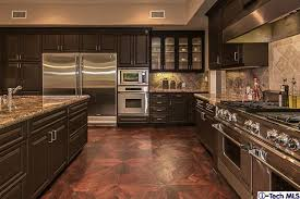 dark chocolate kitchen cabinets dark chocolate cabinets with stainless steel appliances beautiful