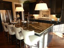 golden fantasy granite with a pillowed natural stone backsplash