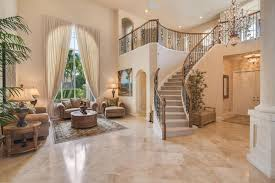 luxury home interior with elegant living room staircase and