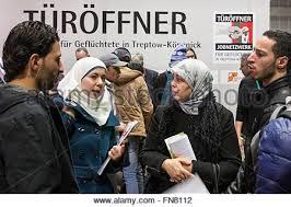 jobs journalismus berlin migrants and refugees walk around stands offering jobs and