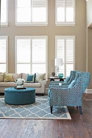 contemporary living room with wingback chair by studio ten 25