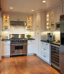 waypoint cabinets with white flowers kitchen traditional and